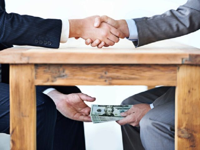 2078959374_Pic-of-Bribery-corruption-money-under-table.jpg